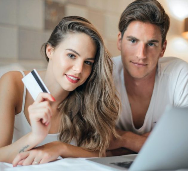 happy-young-couple-doing-purchase-on-internet-together-at-3767397